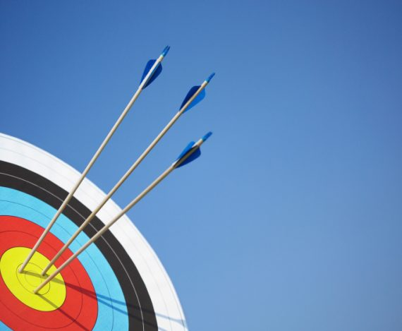 Archery target with arrows in the bull's eye